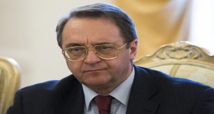 FILE -- In this April 14, 2014 file photo, Russian Deputy Foreign Minister Mikhail Bogdanov meets with Minister of Foreign Affairs of Sudan Ali Ahmed Karti in Moscow, Russia. Bogdanov arrived in the Syrian capital Damascus Wednesday, Dec. 10, 2014 for talks expected to focus on Moscow's efforts to bring all sides in Syria's seemingly intractable civil war to the negotiating table. Damascus is the last leg of a regional tour that has taken Bogdanov to Turkey for meetings with Syrian opposition leaders as well as Lebanon for talks with senior government officials and Hezbollah chief Hassan Nasrallah. (AP Photo/Alexander Zemlianichenko, File)