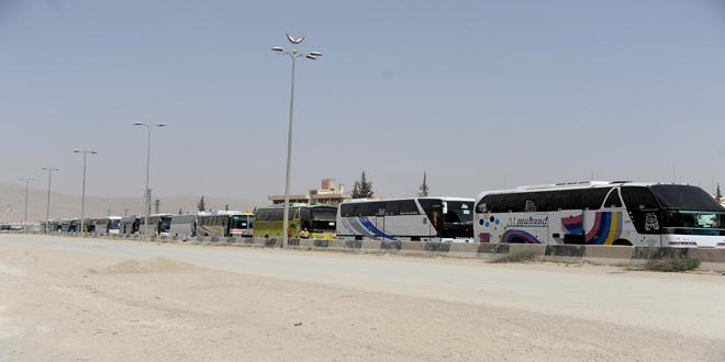 Buses enter Um Batina village in Quneitra countryside to evacuate terrorists
