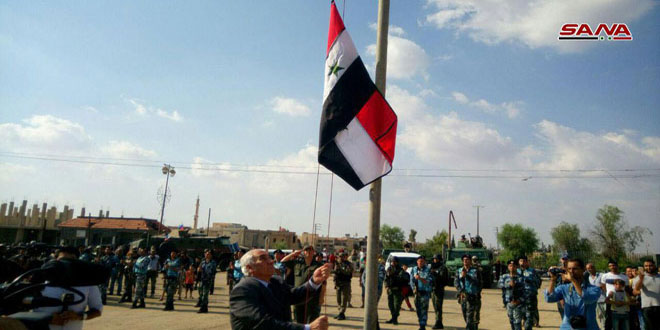 Syrian flag hoisted in Busra al-Sham after cleaning it from terrorism