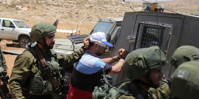 Israeli occupation forces arrest a Palestinian in Bethlehem