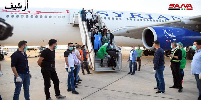 A plane carrying 186 Syrians stranded abroad arrives in Damascus Airport from Amman