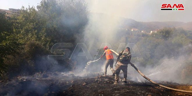 Extinguish a fire in vicinity of Qalatiyeh town, Homs countryside