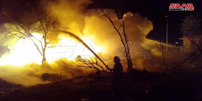 Firemen extinguish fire that erupted in tanker explosion at the Syrian Company for Transporting Crude Oil