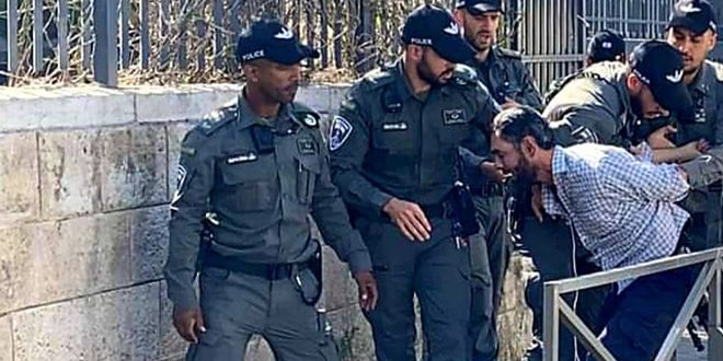 Israeli occupation forces arrest a Palestinian in Ramallah