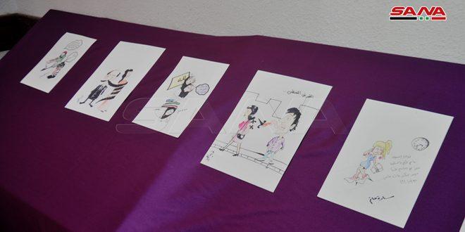 В Сувейде прошла выставка карикатур в рамках акции против гендерного насилия