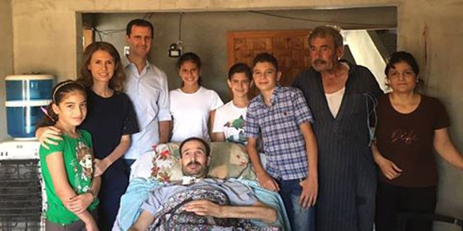 President al-Assad and his family visit injured army ...
