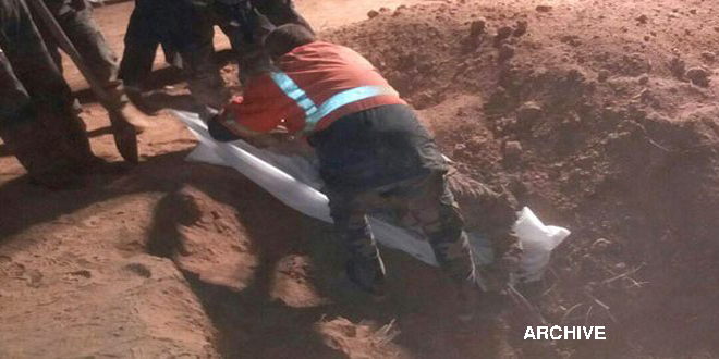 Mass grave for martyrs unearthed in Deir Ezzor