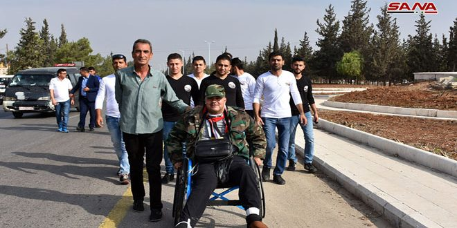 Injured fighter Ghiath Dayoub starts walk from Hama to Damascus on his wheelchair