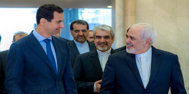 President al-Assad to Zarif: Adherence to national principles and people's interests protects any country