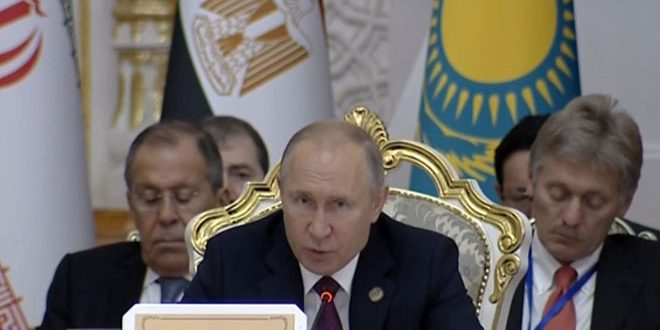Putin calls for finding solution to crisis in Syria