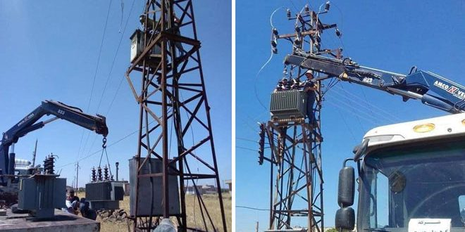 Rehabilitating electrical system damaged by terrorists in two villages in Homs