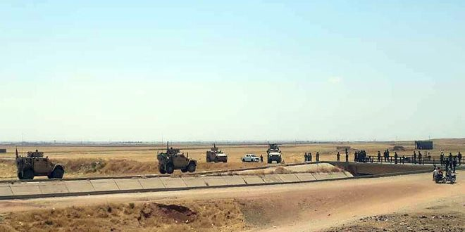 Army personnel intercept a military convoy for US occupation forces in Hasaka northern countryside