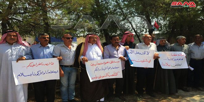 National stand in Zibaneh village in Hasaka, in condemnation of coercive measures on Syria