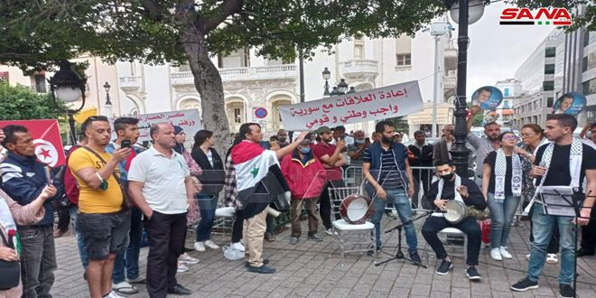 Tunisians stage a solidarity stand, calling for restoring relations with Syria, breaking siege