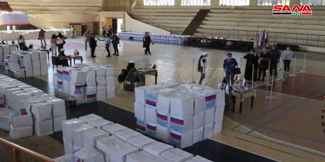 Syrian-Russian Business Council distributes assistance to families affected by terrorism in Homs