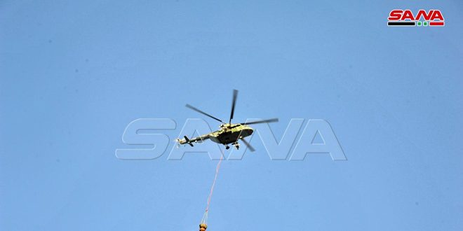 Firefighting brigades, army helicopters continue to put out fire in al-Shaara mountain forests