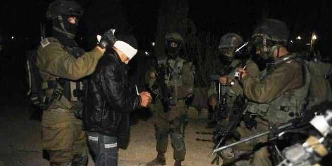 Israeli occupation forces arrest a Palestinian in Hebron