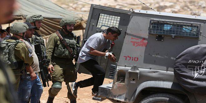 Israeli occupation troops arrest a Palestinian in Bethlehem