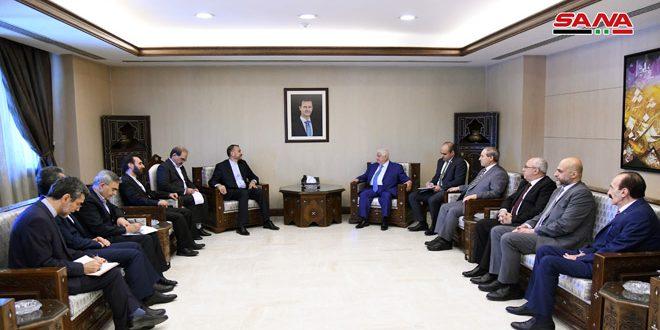El canciller al-Moallem recibe al asistente del presidente del parlamento iraní para asuntos internacionales