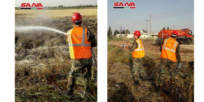 Bomberos de Siria en plena alerta para extinguir incendios intencionados en sembrados de trigo. (fotos)