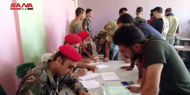 Dera'daki Dael Kentinde Onlarca Silahlı Yasal Durumlarını Çözüp Silahlarını Teslim Etti