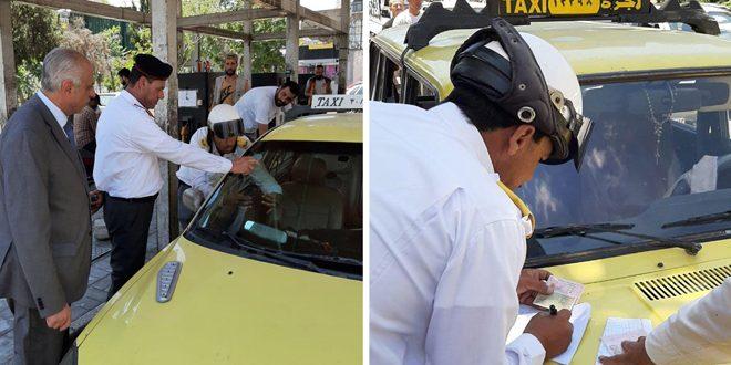 مرور دمشق ينظم ضبوطاً بحق سائقي التكسي لعدم وضعهم لصاقة التعرفة الجديدة