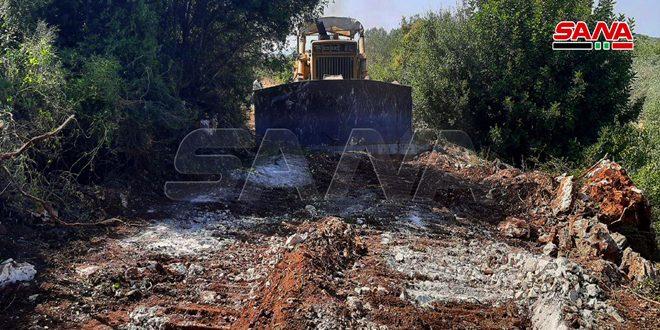زراعة حمص تواصل شق طرق (خطوط نار) في المناطق الحراجية بمنطقة قرب علي